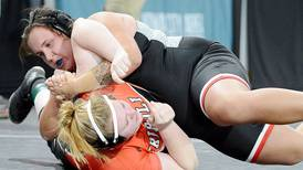 Girls wrestling team's efforts backed by district